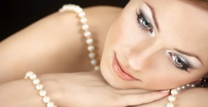 Pretty-woman-wrapped-with-elegant-pearls-2600x1333